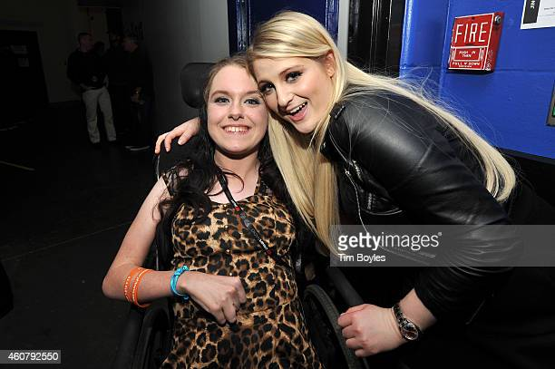 Meghan Trainor visits with fan, Misty Short, during 93.3 FLZ's Jingle Ball 2014 at Amalie Arena on December 22, 2014 in Tampa, Florida.