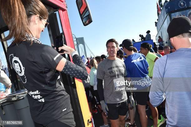 Meghann Gunderman and Jason Sehorn prepare before the start of the 2019 TCS New York City Marathon on November 03 2019 in New York City