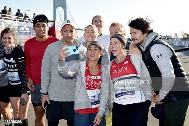 Meghann Gunderman Jordan Andino Nikki Espina Amy Robach Dan Churchill and runners pose before the start of the 2019 TCS New York City Marathon on...