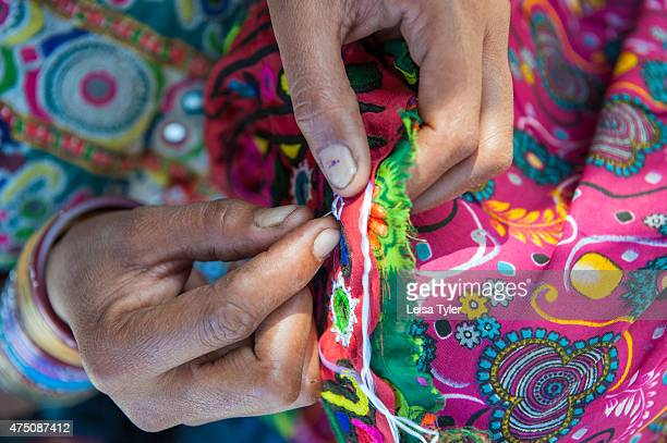 Meghawal woman from Hodka a semiarid region bordering the Great Raan of Kutch embroidering The Meghawal are renowned for their embroidery and...