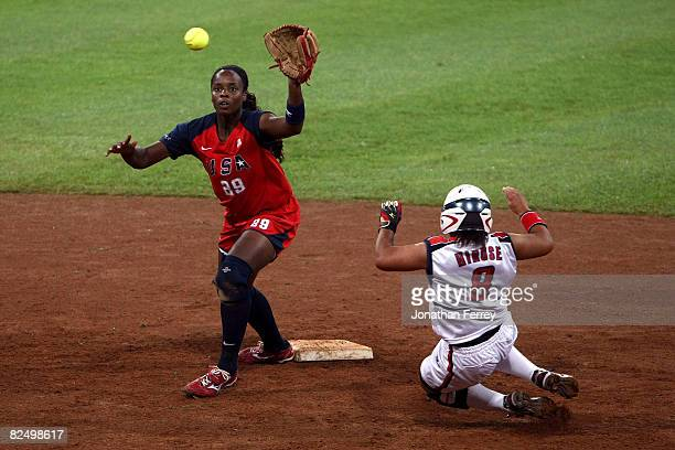 Megu Hirose of Japan slides into second base as shortstop Natasha Watley of the United States waits for the ball during the women's grand final gold...