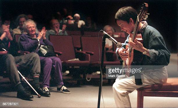 Guitarist.Perform.032698.MB–––Dat Nguyen is a 28–year–old Amerasian orphan who has been blind since birth but who posesses a remarkable gift to play...