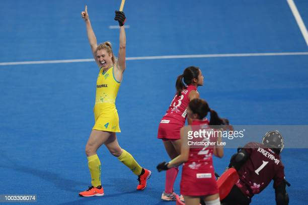 Megumi Kageyama of Japan stops Grace Stewart of Australia during the Pool D game between Australia and Japan of the FIH Womens Hockey World Cup at...
