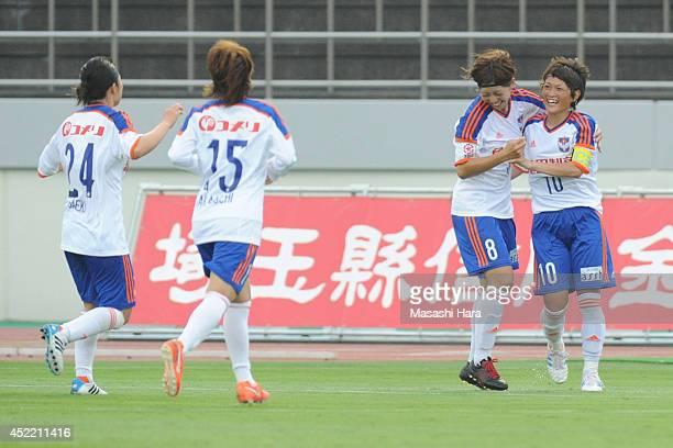 Megumi Kamionobe of Albirex Nigata celebrates the second goal during the Nadeshiko League 2014 match between Urawa Reds Ladies and Albirex Niigata...