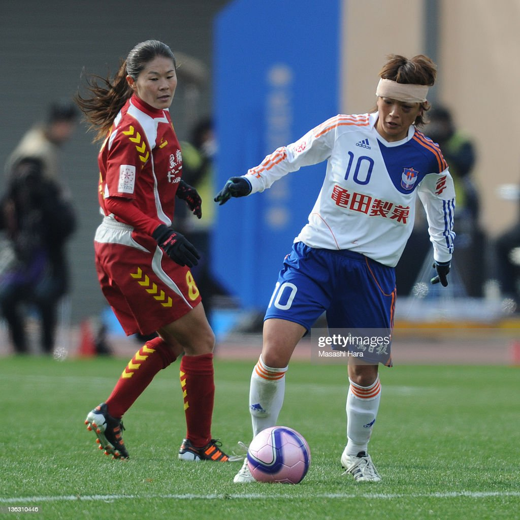 Megumi Kamionobe #10 of Albirex Nigata Ladies (R) in action against Homare Sawa #8 of INAC Kobe Leonessa during the All Japan Women's Soccer Championship Final match between Albirex Niigata Ladies and INAC Kobe Leonessa at the National Stadium on January 1, 2012 in Tokyo, Japan.