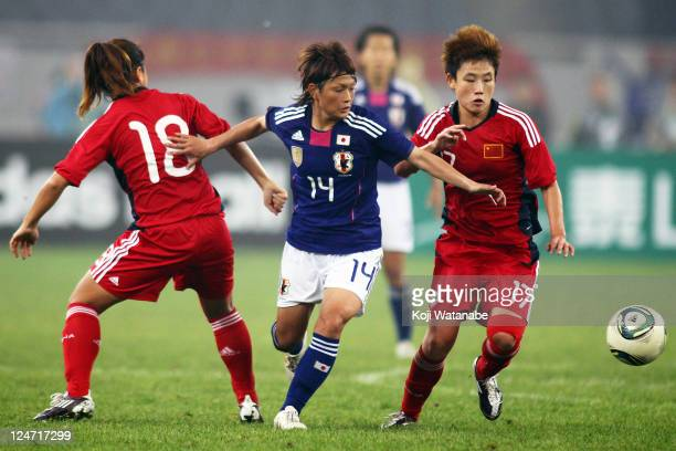 Megumi Kamionobe of Japan and Pang Fengyue of China compete for the ball during the London Olympic Women's Football Asian Qualifier match between...