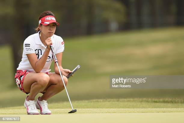 Megumi Kido of Japan looks at her yardage book on the 2nd green during the third round of the World Ladies Championship Salonpas Cup at the Ibaraki...