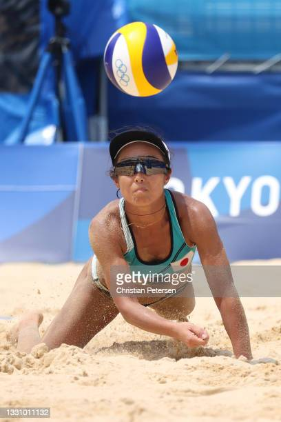 Megumi Murakami of Team Japan hits against Team Switzerland during the Women's Preliminary Round - Pool F beach volleyball on day five of the Tokyo...