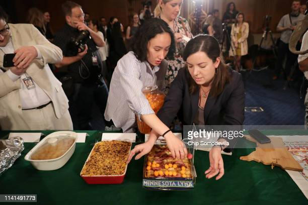 Megumi Rierson Savanna Peterson and Mara Kunin staff members for Rep Angie Craig prepare the Congresswoman's dish for the the ninth annual Minnesota...