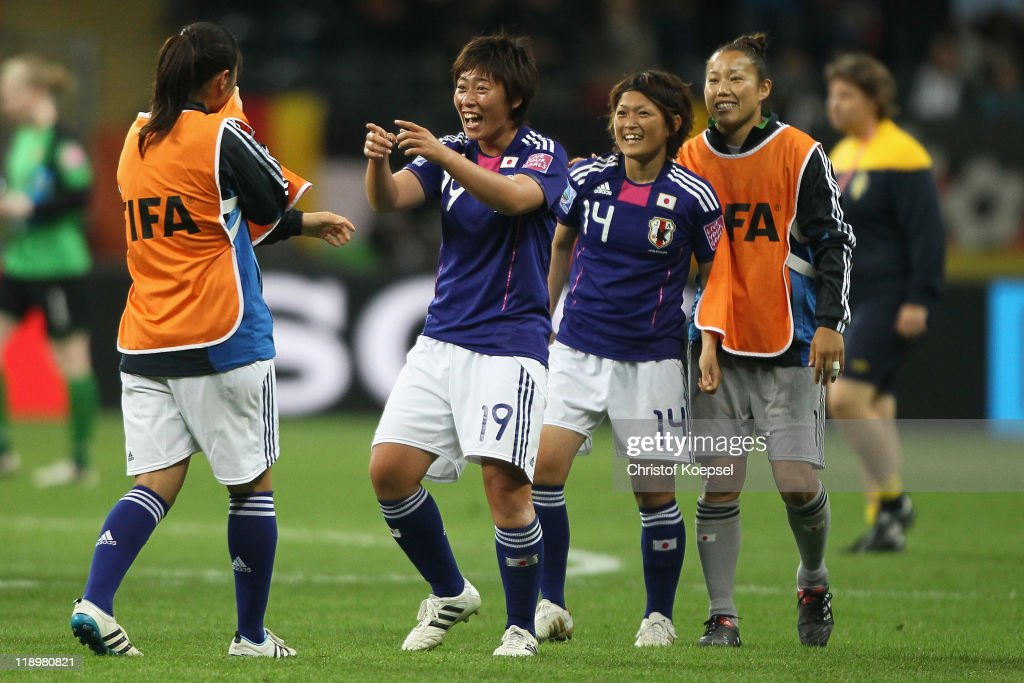 Megumi Takase, Megumi Takase, Megumi Kamionobe and Nozomi Yamago of Japan celebrate winning 3-1 during the FIFA Women's World Cup Semi Final match between Japan and Sweden at the FIFA World Cup stadium Frankfurt on July 13, 2011 in Frankfurt am Main, Germany.