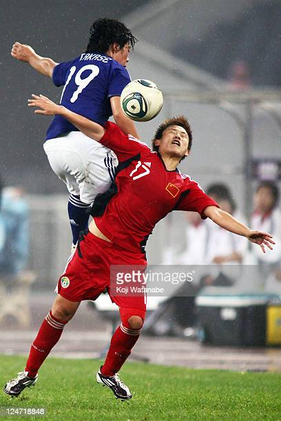 Megumi Takase of Japan and Pang Fengyue of China compete for the ball duringthe London Olympic Women's Football Asian Qualifier match between Japan...