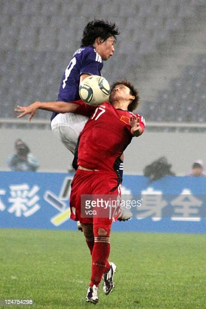 Megumi Takase of Japan and Pang Fengyue of China compete for the ball during the London Olympic Women's Football Asian Qualifier match between Japan...