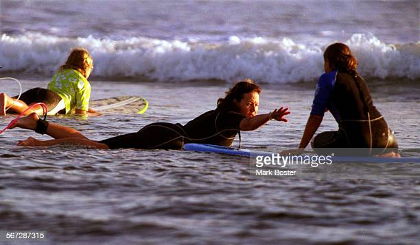 MEHartmanSurf102798MB–––Mary Hartmann extended her hand to one of her surf school students at San Onofre Hartmann is the sister of comedian Phil...