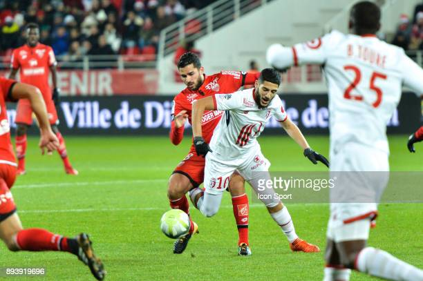 Mehdi Abeid of Dijon and Yassine Benzia of Lille during the Ligue 1 match between Dijon FCO and Lille OSC at Stade Gaston Gerard on December 16 2017...