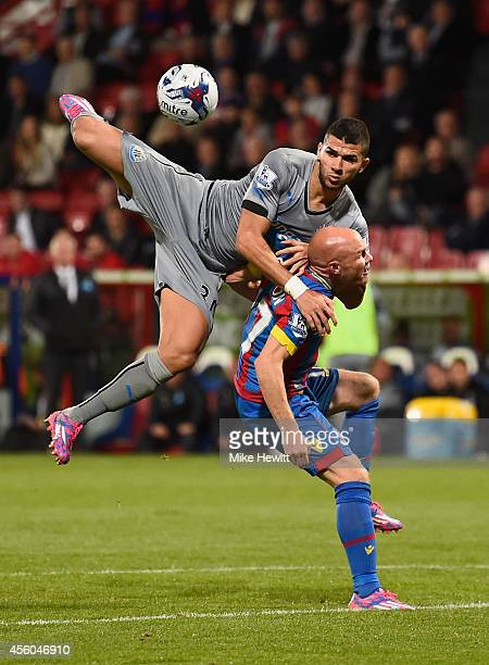 Mehdi Abeid of Newcastle jumps all over Andy Johnson of Crystal Palace during the Capital One Cup Third Round match between Crystal Palace and...