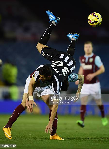 Mehdi Abeid of Newcastle United and Danny Ings of Burnley compete for the ball during the Barclays Premier League match between Burnley and Newcastle...