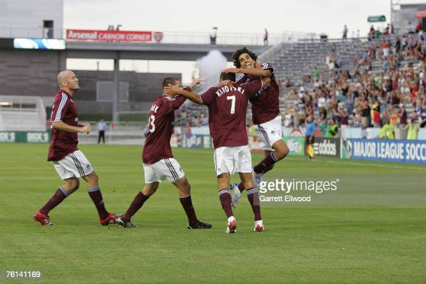 Mehdi Ballouchy celebrates the goal by Jovan Kirovski of the Colorado Rapids during the game against the New England Revolution at Dick's Sporting...