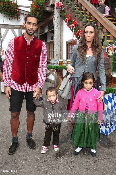 Mehdi Benatia and his wife Cecile son Kays and daughter attend the FC Bayern Wies'n during Oktoberfest at Kaeferzetl/Theresienwiese on October 5 2014...