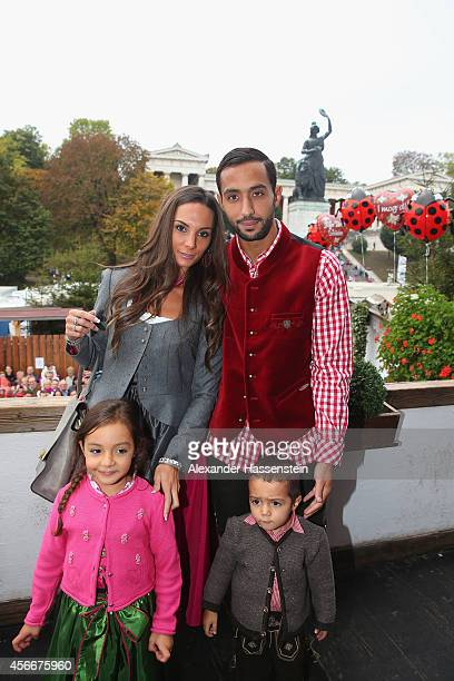 Mehdi Benatia attends with his wife Cecile Benatia and their children Kays and Lina during the Oktoberfest beer festival at Kaefer Wiesnschaenke tent...