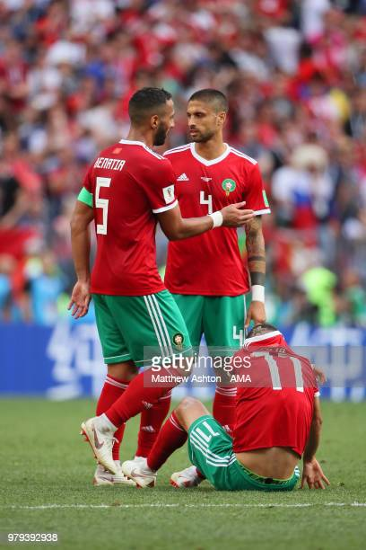 Mehdi Benatia, Manuel Da Costa and Faycal Fajr of Morocco look dejected at the end of the 2018 FIFA World Cup Russia group B match between Portugal...