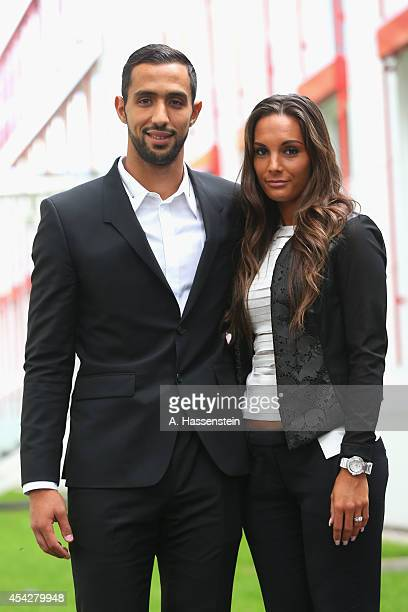 Mehdi Benatia of FC Bayern Muenchen pose with his wife Cecile Benatia after a press conference at Bayern Muenchen's headquarter Saebener Strasse on...