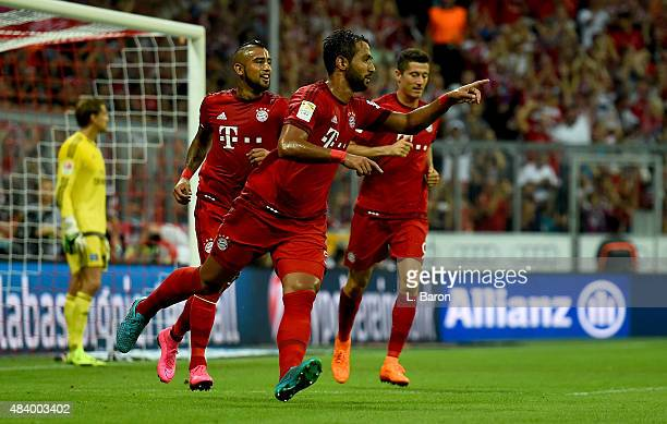 Mehdi Benatia of Muecnhen celebrates with team mates after scoring his teams first goal during the Bundesliga match between FC Bayern Muenchen and...