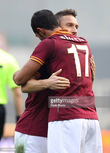 Mehdi Benatia with his teammate Francesco Totti of AS Roma celebrates after scoring the opening goal during the Serie A match between AS Roma and...