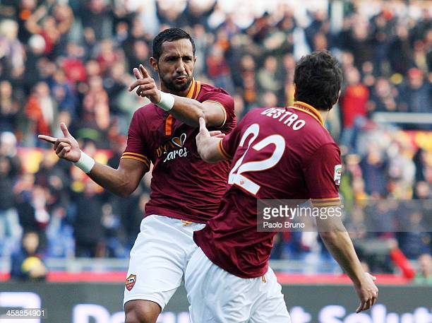 Mehdi Benatia with his teammate of AS Roma celebrates after scoring the opening goal during the Serie A match between AS Roma and Calcio Catania at...