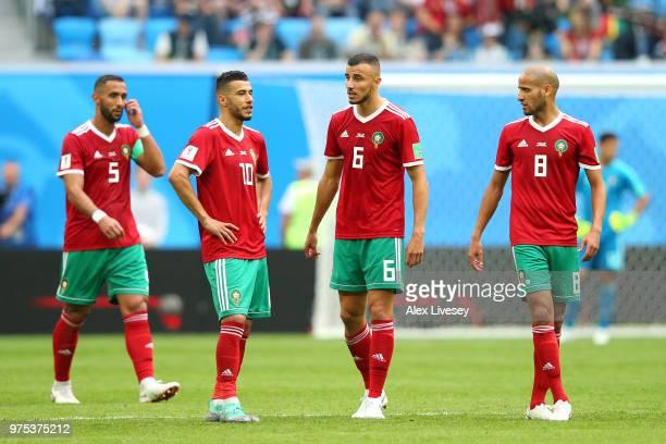 Mehdi Benatia, Younes Belhanda, Romain Saiss and Karim El Ahmadi of Morocco look dejected following their loss during the 2018 FIFA World Cup Russia...