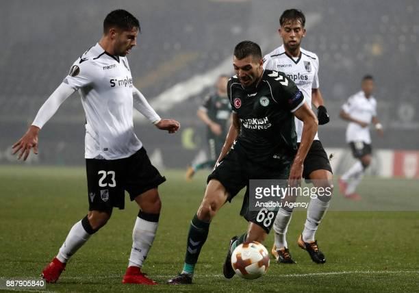 Mehdi Bourabia of Atiker Konyaspor in action against Joao Vigario of Vitoria Guimaraes during UEFA Europa League Group I soccer match between Vitoria...