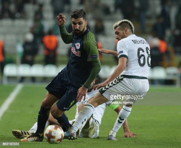 Mehdi Bourabia of Atiker Konyaspor in action against Munas Dabbur of Salzburg during the UEFA Europa League Group I soccer match between Atiker...