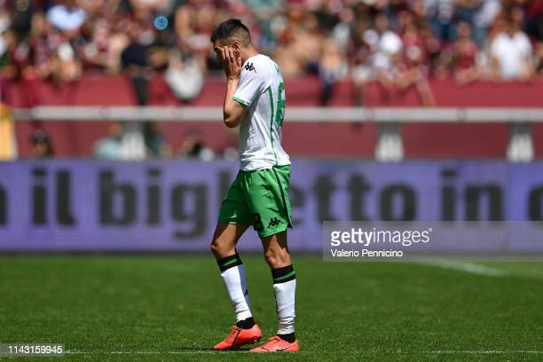 Mehdi Bourabia of US Sassuolo walks off with after receives the second yellow card during the Serie A match between Torino FC and US Sassuolo at...