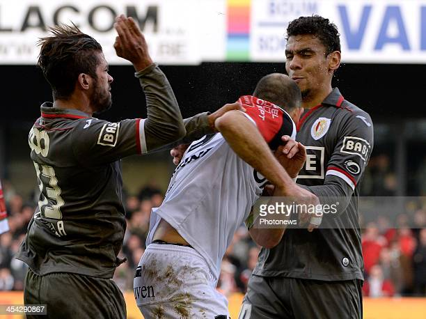 Mehdi Carcela of Standard Liege and Bjorn Ruytinx of OHL pictured during the Jupiler League between OHL vs Standard of Liege at Den Dreef stadium on...