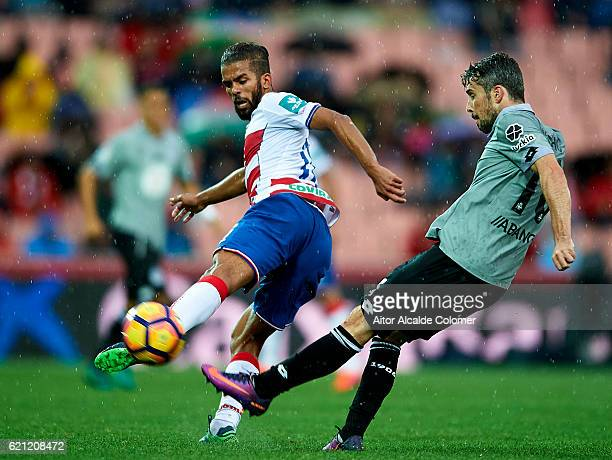 Mehdi CarcelaGonzalez of Granada CF competes for the ball with Luis Carlos Correa 'Luisinho' of Deportivo La Coruna during the match between Granada...