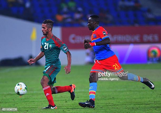 Mehdi CarcelaGonzalez of Morocco vies for the ball against Ndombe Mubele of DR Congo during the African Cup of Nations 2017 Group C match between DR...