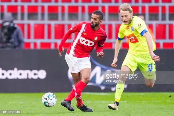 Mehdi Carcela-Gonzalez of Standard de Liege and Roman Bezus of KAA Gent during the Jupiler Pro League match between Standard de Liege and KAA Gent at...