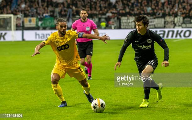 Mehdi Carcela-Gonzalez of Standard Luettich and Daichi Kamada of Eintracht Frankfurt battle for the ball during the UEFA Europa League group F match...