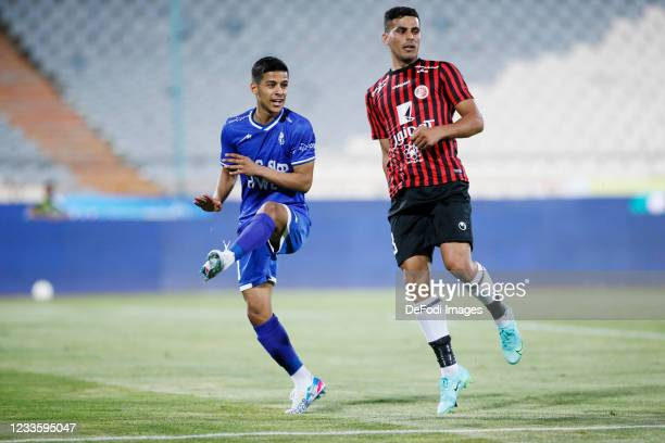 Mehdi Ghayedi of Esteghlal and Ali Nemati of Padideh looks on during the Persian Gulf Pro League match between Esteghlal and Padideh FC at Azadi...