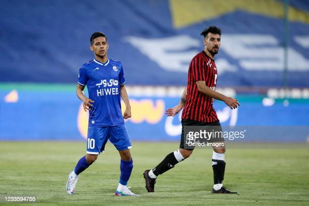 Mehdi Ghayedi of Esteghlal and Amirhossein Karimi of Padideh looks on during the Persian Gulf Pro League match between Esteghlal and Padideh FC at...
