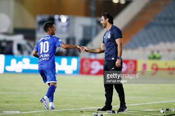 Mehdi Ghayedi of Esteghlal and Head Coach Farhad Majidi of Esteghlal celebrates after scoring his teams second goal with head coach during the...