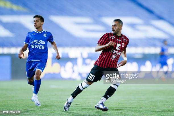 Mehdi Ghayedi of Esteghlal and Yousef Vakia of Padideh looks on during the Persian Gulf Pro League match between Esteghlal and Padideh FC at Azadi...