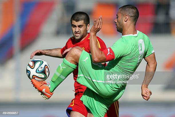 Mehdi Lacen of Algeria fights for the ball with Edgar Manucharyan of Armenia during the international friendly match between Algeria and Armenia at...