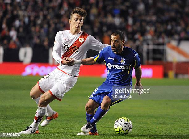 Mehdi Lacen of Getafe is challenged by Diego Llorente of Rayo Vallecano de Madrid during the La Liga match between Rayo Vallecano and Getafe CF at...