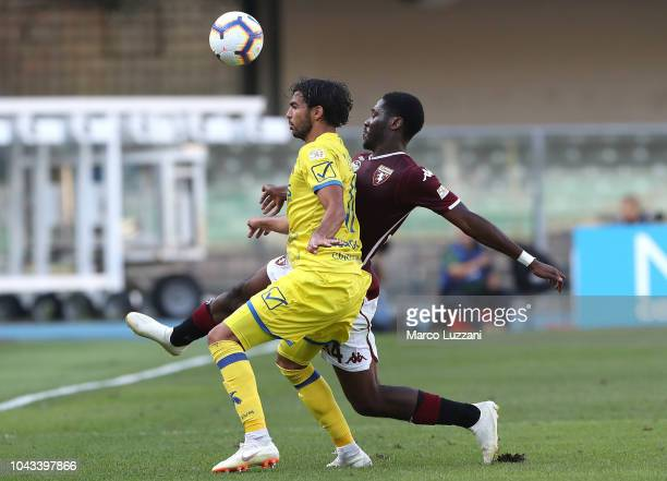 Mehdi Leris of Chievo Verona competes for the ball with Alejandro BerenguerOla Aina of Torino FC during the Serie A match between Chievo Verona and...
