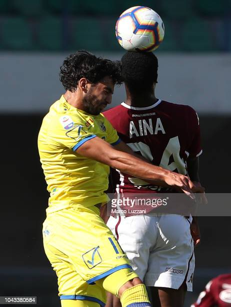 Mehdi Leris of Chievo Verona competes for the ball with Ola Aina of Torino FC during the Serie A match between Chievo Verona and Torino FC at Stadio...