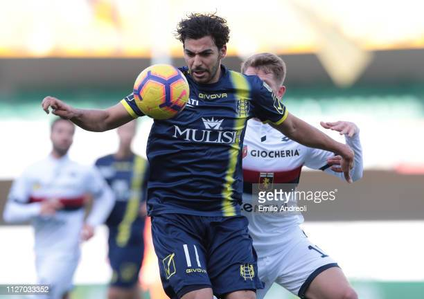 Mehdi Leris of Chievo Verona is challenged by Esteban Rolon of Genoa CFC during the Serie A match between Chievo Verona and Genoa CFC at Stadio...