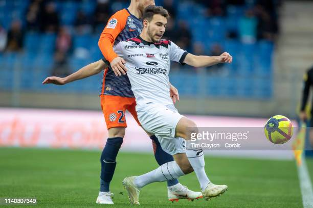 Mehdi Merghem of Guingamp challenged by Mihailo Ristic of Montpellier in action during the Montpellier V Guingamp French Ligue 1 regular season match...