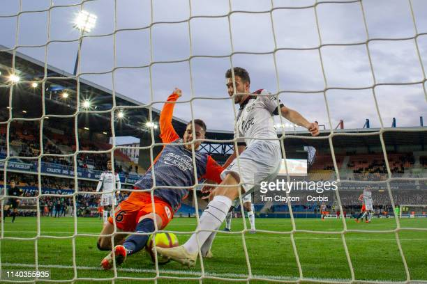 Mehdi Merghem of Guingamp makes a spectacular goal line clearance as he is challenged by Mihailo Ristic of Montpellier during the Montpellier V...