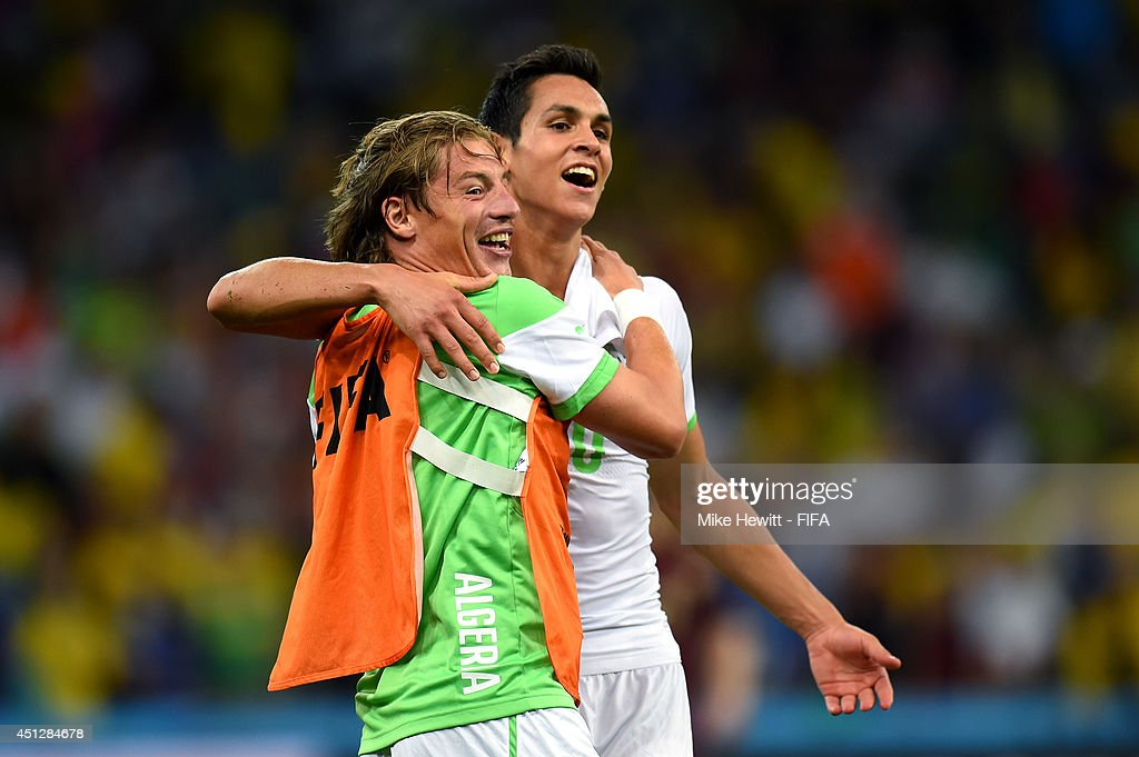 Mehdi Mostefa (L) and Aissa Mandi of Algeria celebrate after a 1-1 draw during the 2014 FIFA World Cup Brazil Group H match between Algeria and Russia at Arena da Baixada on June 26, 2014 in Curitiba, Brazil.