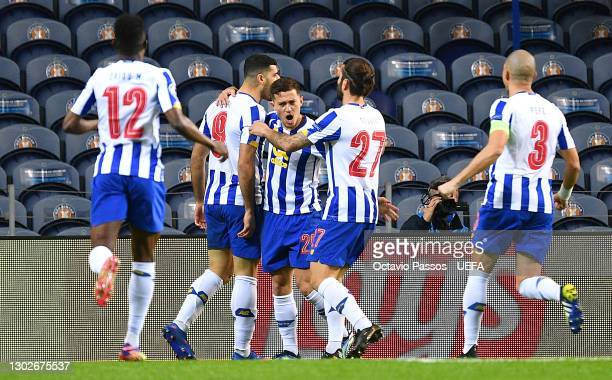 Mehdi Taremi of FC Porto celebrates with team mates after scoring their side's first goal during the UEFA Champions League Round of 16 match between...